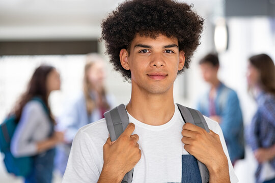 African guy standing with backpack in high school