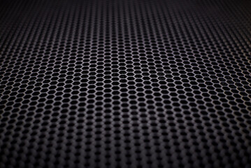 A black metal grate as a background.