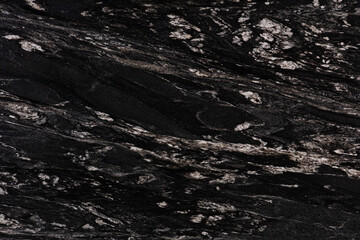 Cosmic Black - natural polished dark granite stone slab, texture for interior, background or other design project.