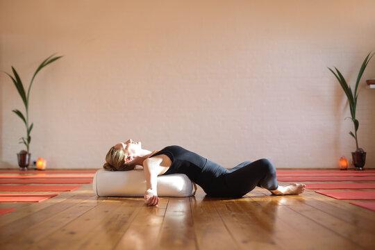 Woman practicing yoga at home during quarantine