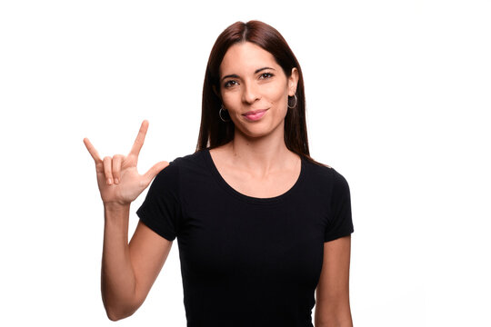 Isolated in white background brunette woman saying  I love you in spanish sign language