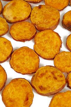 baked sweet potato slices isolated on white
