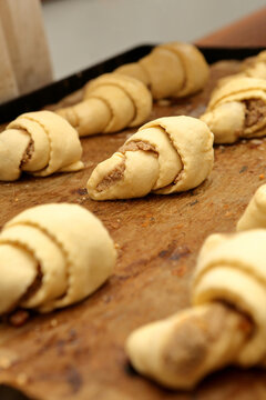 Fresh raw croissants stuffed before putting into the oven