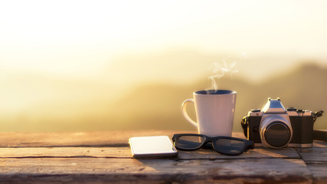 Cup ice coffee on wood tree outdoor over mountains landscape with sunlight. Beauty nature background. Lifestyle Concept