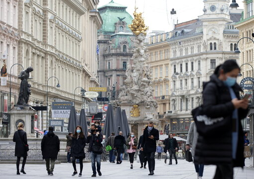 People with protective masks walk past Graben shopping street as the coronavirus disease (COVID-19) pandemic continues in Vienna