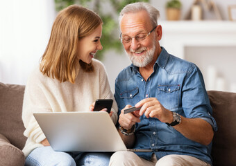 Photo sur Plexiglas Dinosaurs Young woman with father shopping online at home.