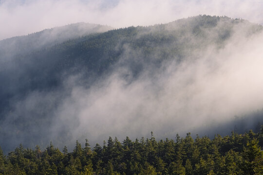 Morning fog over the ridge leading to the top of Mount Monadnock on an autumn morning in Jaffrey New Hampshire