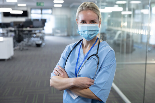 Portrait of female health professional wearing face mask at workplace