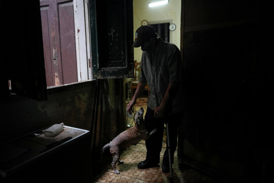 Cuban pensioner Filiberto Suarez in his home