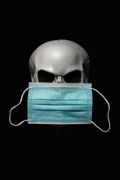 Evil Human Skull with Surgical Mask