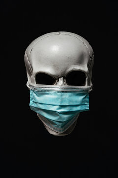 Doubtful Human Skull with Surgical Mask