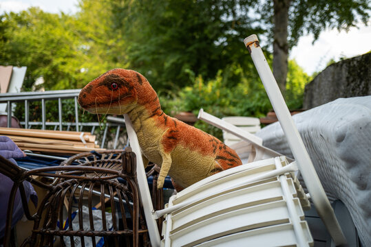 An abandoned old dinosaur toy