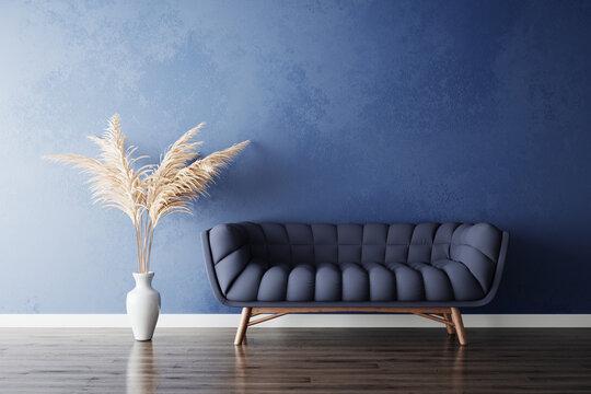 Blue sofa and white pampas grass vase