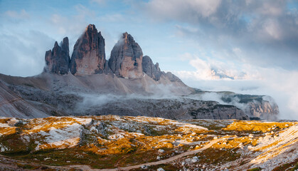 Wall Mural - Foggy view of the national park Tre Cime di Lavaredo.