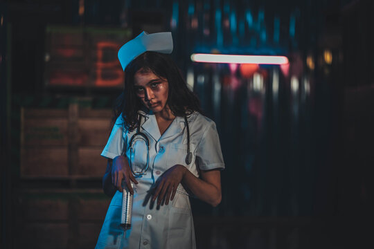Horror scary evil insane nurse doctor held the knife, Zombie woman gosth with halloween concept