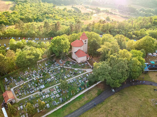 Airplane view to the landscape of Czech republic with old church and graveyard