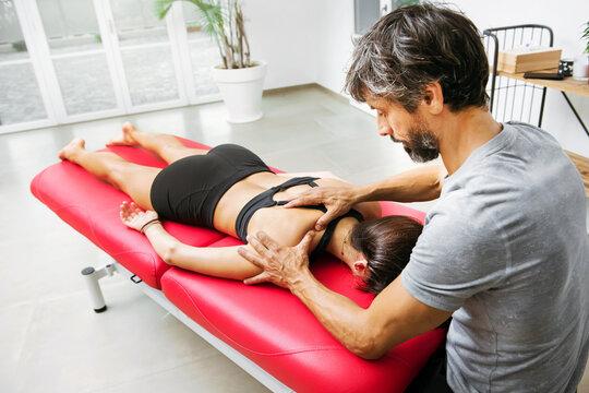 Osteopath doing a supraspinatus myofascial massage
