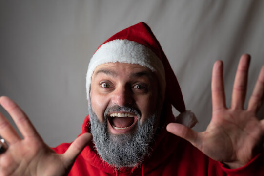 Santa Claus is happily surprised and throws up his hands
