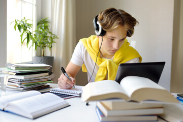 Teenager boy study at home. Online education and distance learning for children. School boy doing...