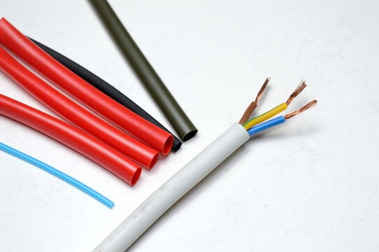 heat shrink tubing and a three-core stripped wire on a white background.
