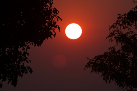 Rising Sun in haze caused by 2020 California Wildfires at South East City Park, Canyon, Texas.