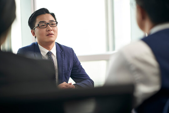 young asian business person being interviewed by hr managers