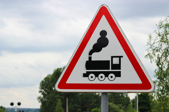 International road sign 'Railroad crossing without a barrier'