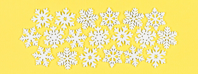 Wall Mural - Top view of winter ornament made of white snowflakes Banner on colorful background. Happy New Year concept with copy space