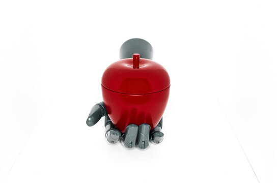 robotic hand with artificial apple