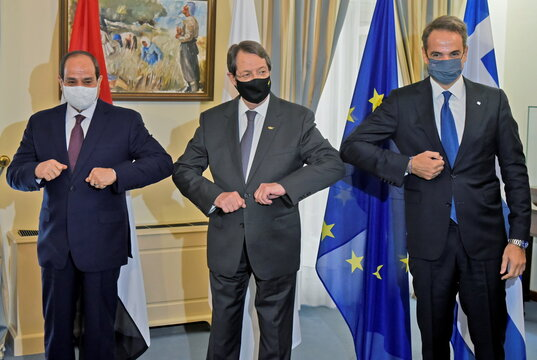Cypriu's President Anastasiades, Greece's Prime Minister Mitsotakis and Egypt's President Abdel Fattah al-Sisi  share an elbow bump during a meeting at a trilateral summit between Greece, Cyprus and Egypt, at the Presidential Palace in Nicosia