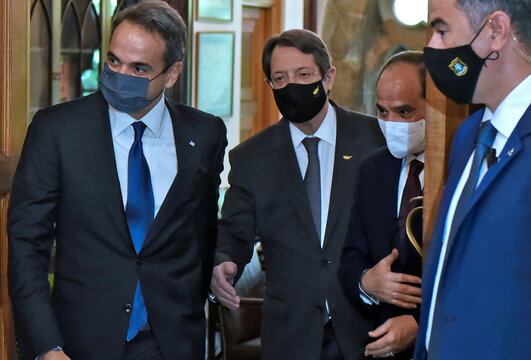 Cypriu's President Anastasiades, Greece's Prime Minister Mitsotakis and Egypt's President Abdel Fattah al-Sisi  are seen during a meeting at a trilateral summit between Greece, Cyprus and Egypt, at the Presidential Palace in Nicosia
