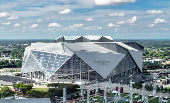 Atlanta's iconic Mercedes Benz Stadium can accommodate 71,000 spectators and features a state-of-the-art retractable roof. Featured here is an aerial view of Mercedes Benz Stadium in Atlanta, Georgia.