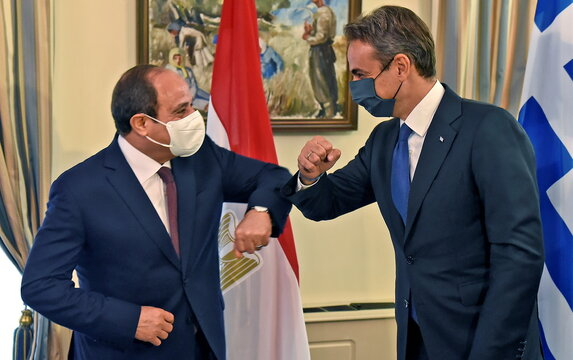 Greek Prime Minister Kyriakos Mitsotakis and Egyptian President Abdel Fattah al-Sisi  share an elbow bump during a meeting at a trilateral summit between Greece, Cyprus and Egypt, at the Presidential Palace in Nicosia