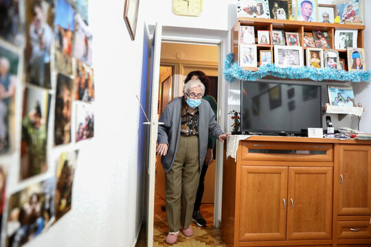 Florentina Martin, a 99 year-old woman who survived coronavirus disease (COVID-19), enters a room at her home in Pinto