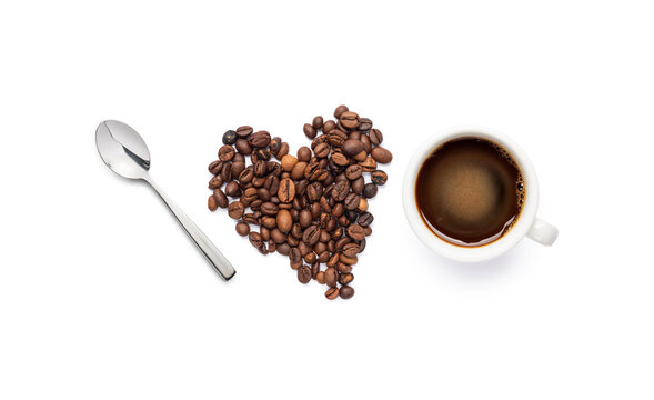 composition with coffee beans, spoon and black coffee cup