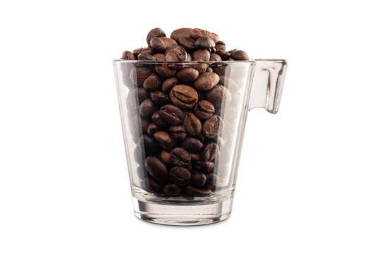 glass cup full of coffee beans on white background