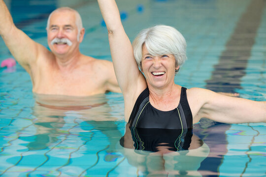 active seniors doing water exercises