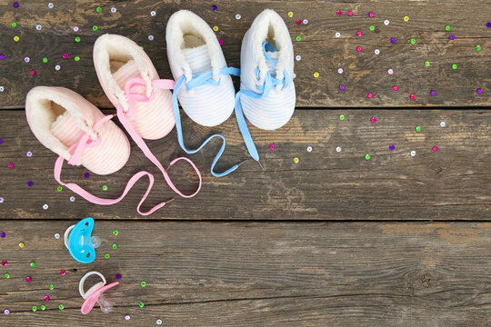 2021 new year written laces of children's shoes and pacifier on old wooden background. Top view. Flat lay.