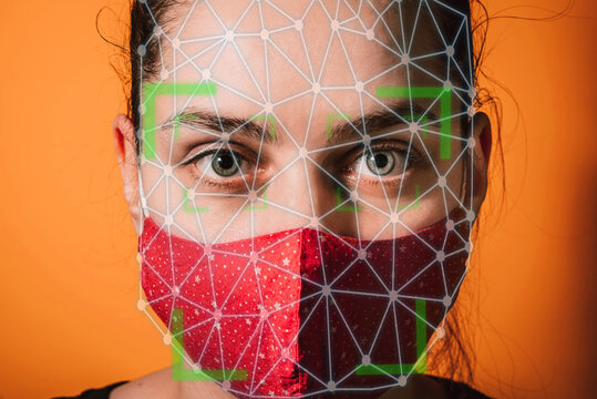Woman with face mask using facial recognition AI system, artificial Intelligence . Biometric scanning Face ID facial mask