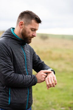 runner checking his smart watch