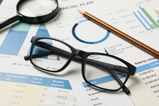 Concept of financial planning with accessories, close up