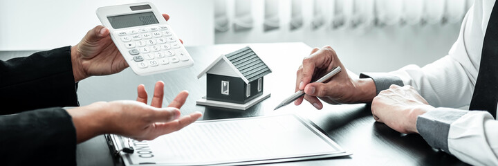 Fototapeta Sale Estate agent are presenting home loan to customer to decision signing contract to rental house insurance with approved property form obraz