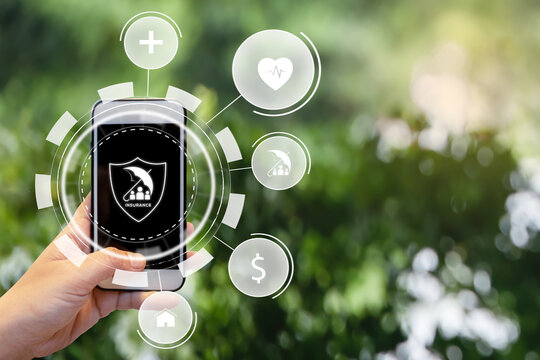 Hand holding smartphone for select insurance technology (Insurtech). Insurance concept.