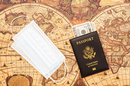 American passport in patriotic background for travelers with a mask.