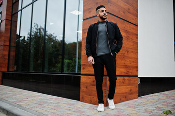 Portrait of stylish arab beard man wear grey turtleneck and black jaket. Arabian model guy.