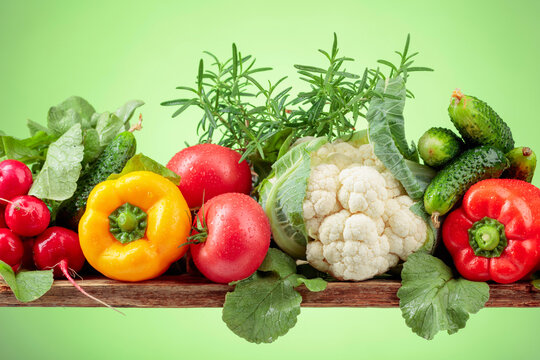 Various fresh raw vegetables, frontal view.