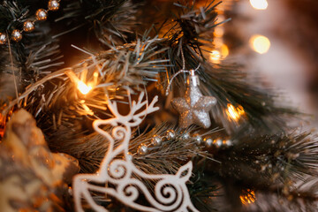 Christmas toys silver deer on a Christmas tree close-up. Christmas and new year, cozy christmas...