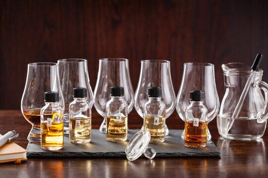 tasting bottles and glasses of whisky spirit brandy cognac. tasting at home