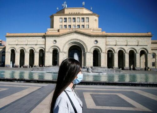 Woman walks in central Yerevan