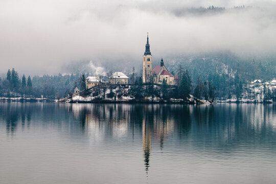 View of Bled lake in the morning, Slovenia. Fog over the famous landmark
